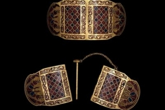 Two Shoulder Clasps, like Roman badges of rank, each have over 900 garnets in tight gold outlined cells